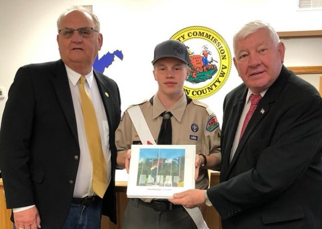 Eagle Scout Philip Lyons presents his project to Commissioners Mitch Morrison and Dick Waybright.