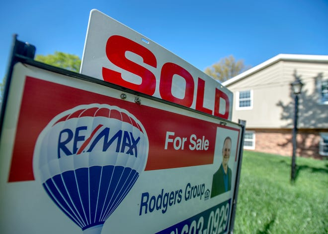 """""""Sold"""" tops a Realtor's sign in the front yard of a recently purchased house in Dunlap."""