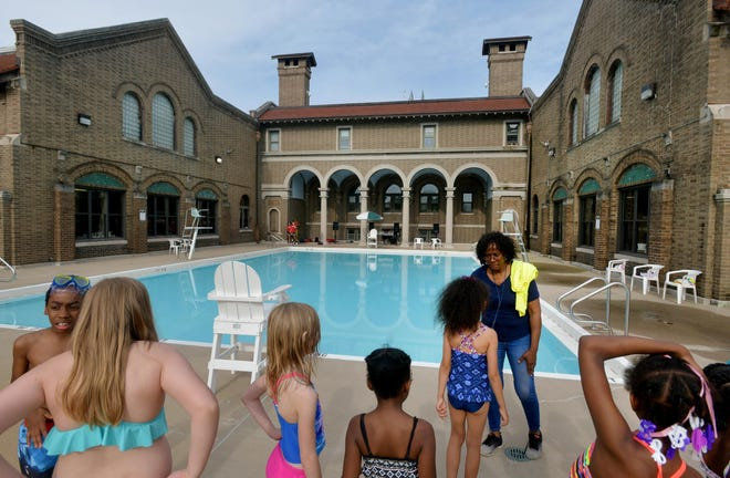Kids attending the Streets Belong to Me youth rally wait for permission to enter the pool Tuesday, May 28, 2019 at Proctor Recreation Center in Peoria.