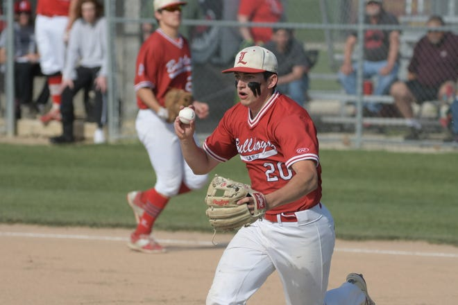 La Plata's Riley Cases works in a rundown at third base before tagging out Novinger's Karchy Farrell on Wednesday night.