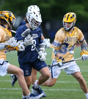 Hudson's Ian Ludewig controls the ball against St. Ignatius' Kyle Geary (34) during the Explorers' 7-5 win Wednesday night. [Photo courtesy of Timothy Howard]