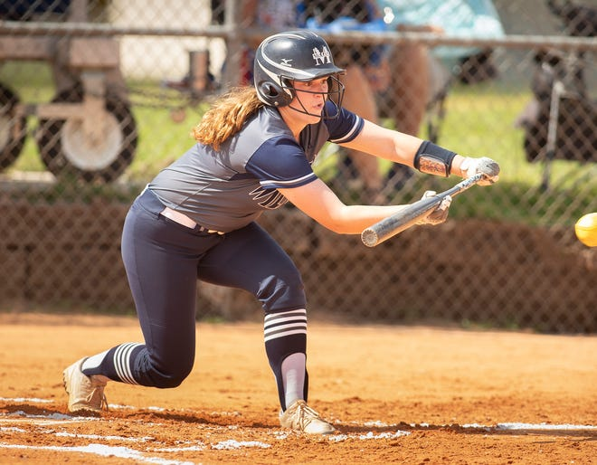 Mckeel's Sophia Sullivan lays down a bunt against Berkeley Prep during a Class 3A, Region 3 quarterfinal game at McKeel. Sullivan homered later in the game.