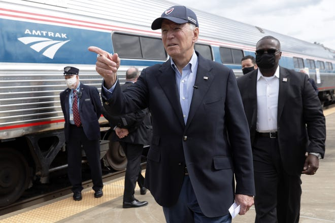 Joe Biden gestures during a campaign stop at Alliance Amtrak Station Sept. 30, 2020, in Alliance, Ohio. (Alex Wong/Getty Images/TNS)
