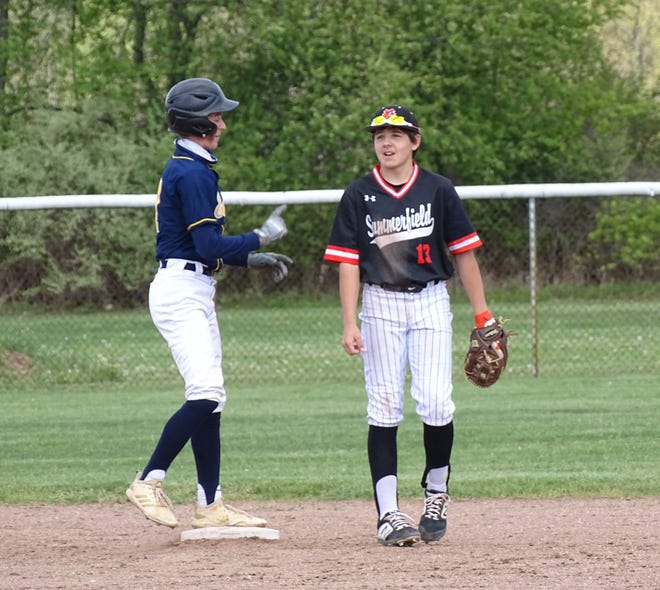 Erie Mason's Aidan Keane (left) chats with his cousin Logan Keane of Summerfield at second base Wednesday.