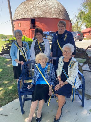 Members of the Oklahoma Society, Colonial Dames of the 17th Century attended the dedication of a bench at the Arcadia Round Barn. Carma Jenkins, honoree, is seated on the bench with State President Orriene Denslow. Behind them are former state presidents Diane King, Joyce Johnson and Sue Allen.