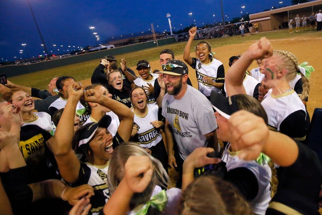 Broken Bow coach Jimmie Wyrick celebrates with his team after winning the Class 5A slowpitch softball state title Wednesday night in Shawnee.