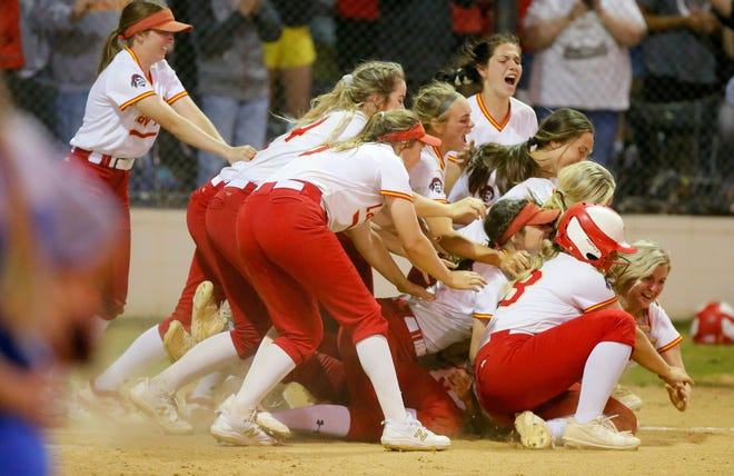 Dale players celebrate after winning the Class 4A state slowpitch softball championship game at the Ball Fields at Firelake in Shawnee on Wednesday. Dale has won five consecutive slowpitch titles.