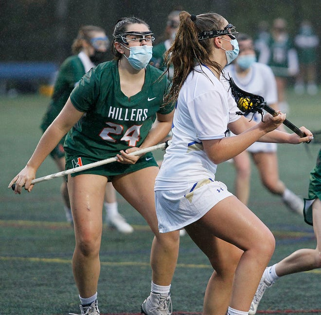 Hopkinton's Katya Markovich (left) defends Norwell's Danielle Cox who looks for a teammate to pass to in a game on May 5, 2021. The Hillers defeated rival Ashland on Friday to improve their record to 1-1 on the year.