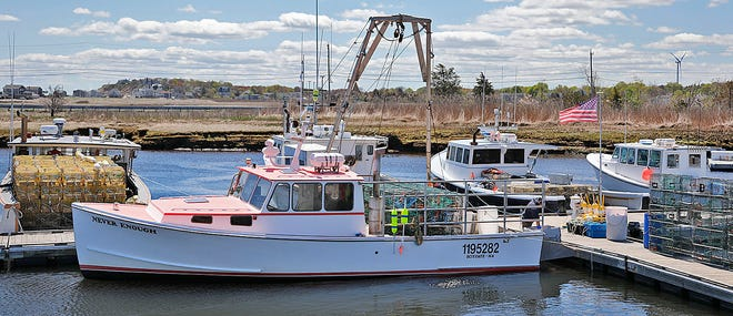 Lobster boats are loaded with gear in Scituate Harbor on Thursday, May 6, 2021.