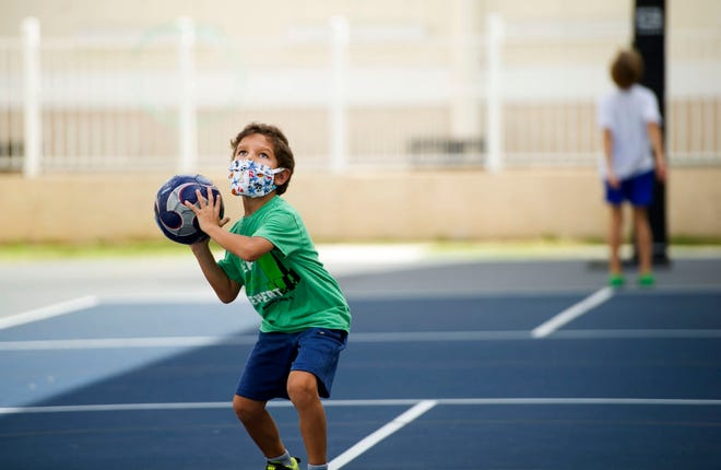 Max Principe, 6, throws a soccer ball during Mad Science summer workshop for children ages 5 though 12 at The Morton and Barbara Mandel Recreation Center in July 2020. Masks will still be required indoors for kids and teens who attend Camp Palm Beach at the recreation center this summer. [MEGHAN MCCARTHY/palmbeachdailynews.com]