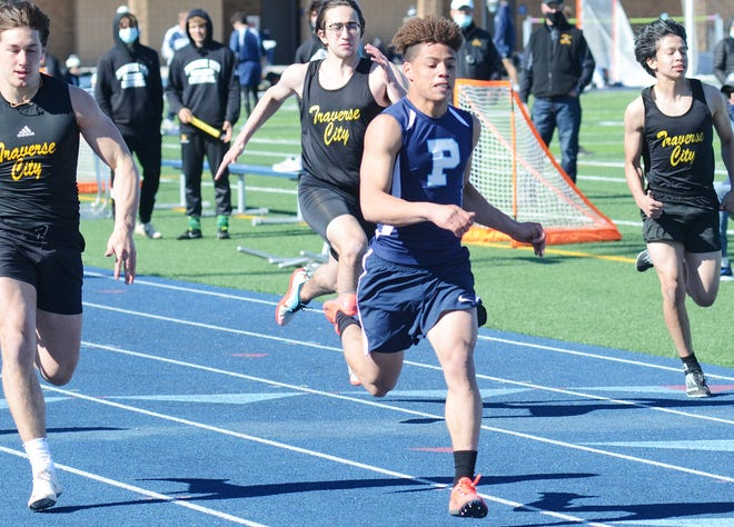 Petoskey's C.J. Hibbler sprints into the finish line of the 100 meter dash, which he won with a new personal best on the day.
