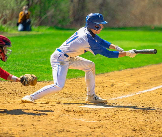 Winnacunnet junior Ty Mitchell tries to lay down a bunt during Saturday's Division I baseball game against Pinkerton.