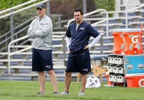 Dave Ziegler, right, and Monti Ossenfort, then-director of college scouting for the Patriots, at a practice.