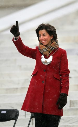 Gov. Gina Raimondo on the State House steps at her first inauguration, on Jan. 6, 2015.