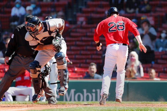 Detroit Tigers' Niko Goodrum (28) scores on a single by Xander Bogaerts as Detroit Tigers' Wilson Ramos fields the throw during the fourth inning of a baseball game, Thursday, May 6, 2021, in Boston. (AP Photo/Michael Dwyer) ORG XMIT: MAMD106