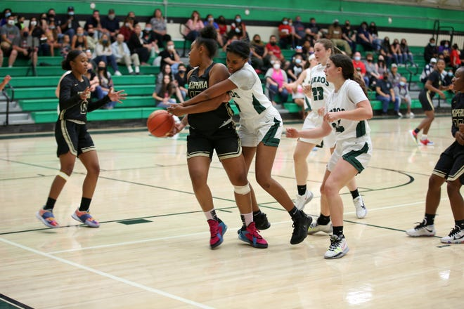 Tiara Manns makes an aggressive move for the ball against the Scorpions. Burroughs High School girls basketball head coach Laura Larson said she was impressed with Mann's play against Hesperia Tuesday night.