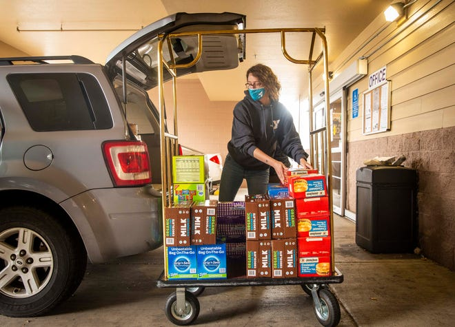 Amber Alexander unloads food from her car in front of The Red Lion Inn for people displaced by the Holiday Farm Fire. Eugene Family YMCA has partnered with Homes for Good and Burrito Brigade after receiving a $15,000 grant from Y-USA to address food scarcity in the community.