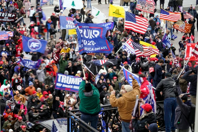 Violent protesters gather outside the U.S. Capitol on Jan. 6.