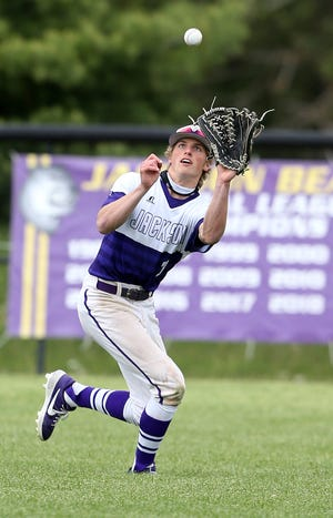 Jackson outfielder Johnny Kulich makes an out against Green Wednesday, May 5, 2021.