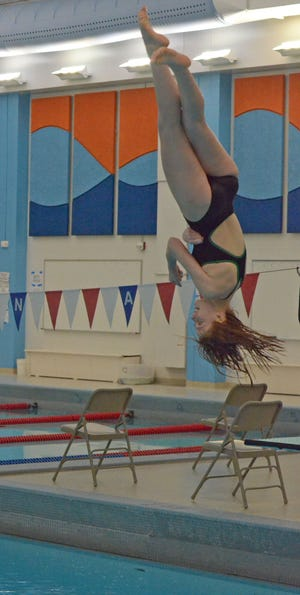 Salina South's Kamryn Kelsey turns in mid-air while competing in the diving competition at the Salina Invitational at the South Natatorium on Thursday. Kelsey, a freshman, qualified to compete at the state meet later this month in Topeka.