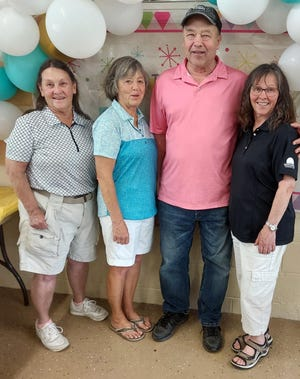 Seifert quads, from left: Monica Clayton, Martha Anderson, Mike Seifert, and Marie Hoffman