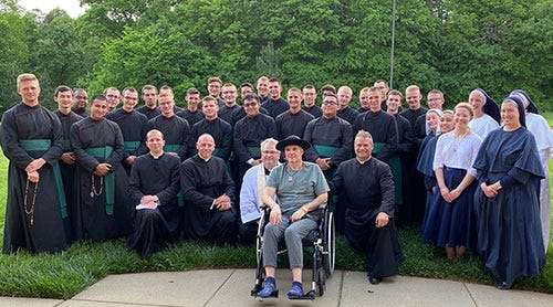 Gathering around Father Michael Kottar before he left for Ohio  were Monsignor Patrick Winslow, the diocese's vicar general and chancellor, and from St. Joseph College Seminary: Father Matthew Kauth, rector, Father Jason Christian, Father Matthew Buettner, the 27 college seminarians, and members of the Daughters of the Virgin Mother.