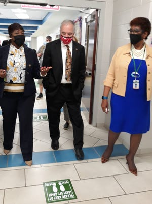Tahisha Wright, principal of the School of Humanities at Juliette Gordon Low Elementary School (left), gives a school tour to State Superintendent Richard Woods and Savannah-Chatham County Schools Superintendent Ann Levett on Thursday.