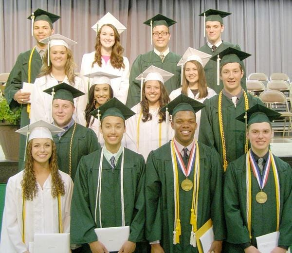 Seniors receiving awards at Wethersfield High School's 2016 commencement are shown wearing gowns and caps in traditional colors of green for boys and white for girls. This year's Class of 2021 will be the last in which boys and girls will wear separate colors.