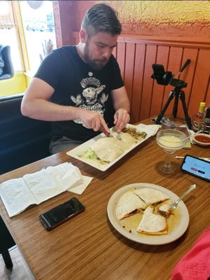 John Taylor took on Fernando's Burrito challenge Wednesday, tackling almost six pounds of food for a good cause. Taylor used the challenge to raise money for a new dance floor that will be in front of the stage at Wiley Park in Galva. The challenge raised about $700 towards the project.