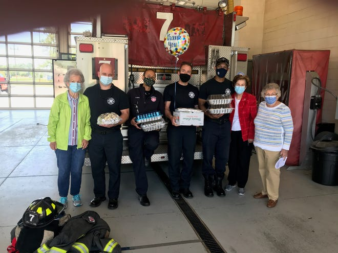 Wilmington Woman's Club members visit with firefighters.