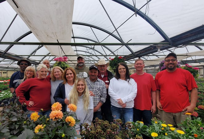 Pictured is the team at Russ BEADLE Landscaping, located at the greenhouse, which is located north of Aberdeen