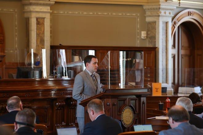 Rep. Blake Carpenter, R-Derby, speaks in favor of legislation creating a medical marijuana program in Kansas Thursday at the Statehouse.