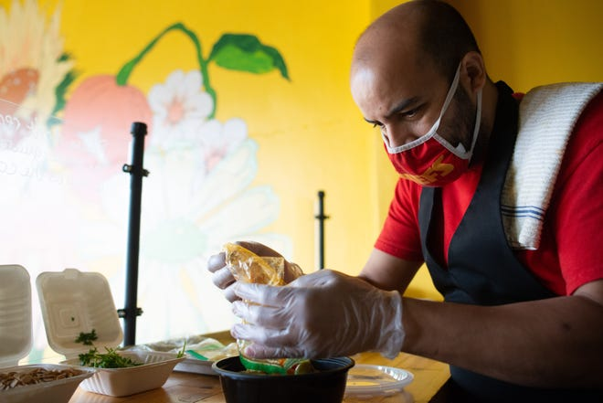 Rida El Azri Ennassiri, chef and owner of Tagine, fixes a bowl of roast beef tagine Wednesday at Josey Baking Co., 3119 S.W. Huntoon St. Ennassiri uses bags to keep the ingredients separated and fresh. When customers place an order, it's quickly prepared on the spot.