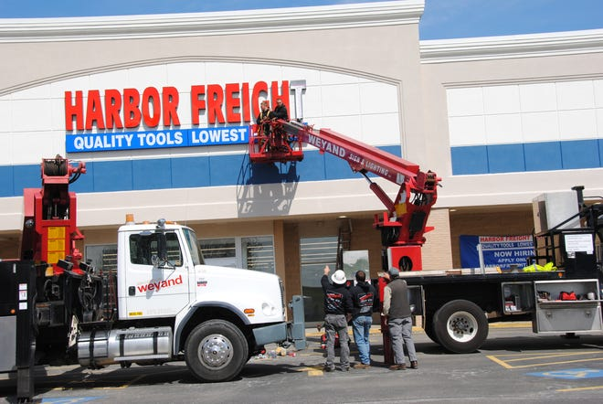 Harbor Freight gets its signage Thursday with the work done by Weyand Sign & Lighting out of Stoystown. The project took about 8 hours. Eric Brice, left, and Brennan Nicklow are in the boom lift working on one letter at a time.