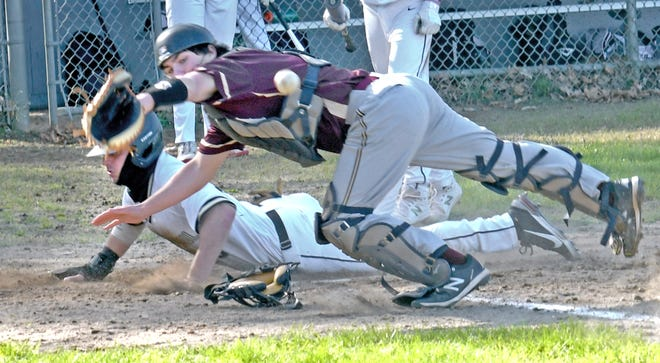 St. Paul base runner Max LeFrancoise scores on a double-steal attempt, as Algonquin Regional catcher Andrew Carlson lunges for the throw at Tivnan Field on Thursday in Worcester.
