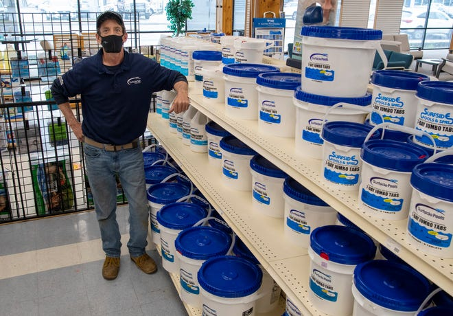 Brian Mulroy, manager at Surfside Pools in Leominster, stands in the chlorine aisle Tuesday.