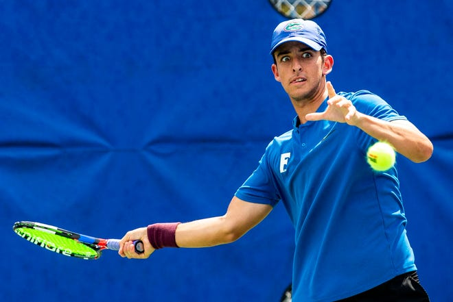 Andy Andrade won his match in straight sets Sunday at the Ring Tennis Complex on campus. [File]