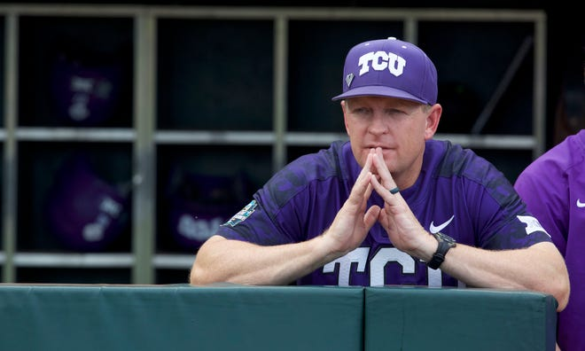 In this June 24, 2017, photo, TCU Horned Frogs head coach Jim Schlossnagle looks out from the dugout prior to a game against the Florida Gators at the College World Series in Omaha, Neb.