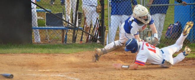 Williamsport catcher Kaden Jackson charges to tag Boonsboro baserunner Carter Stotelmyer, who was trying to score on an unsuccessful squeeze bunt in the sixth inning. The play ended up becoming an unlikely double play on Wednesday to help the Wildcats survive for a 5-3 victory.