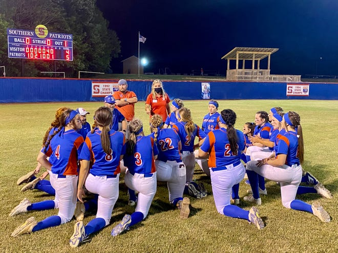 The Southern Alamance softball team huddles in the outfield following its 5-4 victory against Eastern Alamance in the second round of the state playoffs Wednesday night.