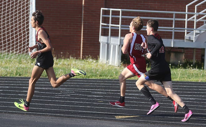 New Philadelphia's Owen Brady leads the way in the 1,600 at the dual meet at Dover Thursday.