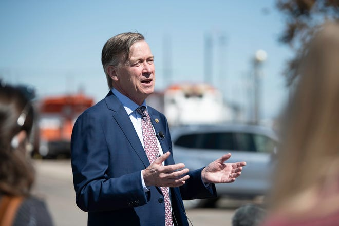 U.S. Sen. John Hickenlooper speaks about the future of the front range rail system at the Union Depot on Thursday May 6, 2021.