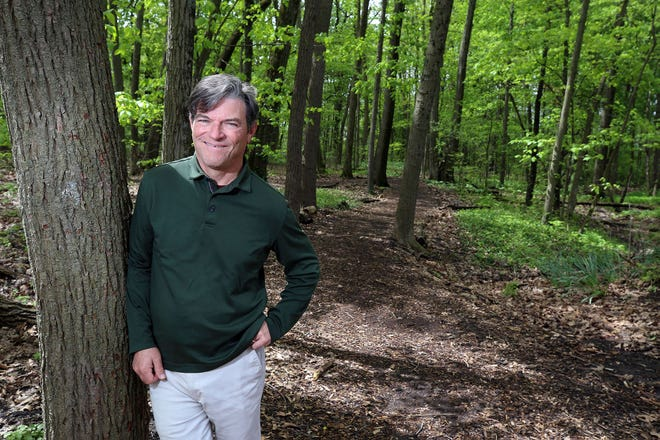Marble Cliff Mayor Matt Cincione leans against a tree at Tarpy Woods. The park is undergoing some improvements, including the creation of Studebaker Grove, where residents could pay to plant a tree with a plaque in honor or memory of a loved one. The grove is named after former mayor Kent Studebaker.