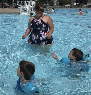 Laura Shank of Pickerington swims with her sons, Henry and Oliver, last year at the Pickerington Community Pool. Attendance will be 300 per session this year after being limited to 125 a year ago.