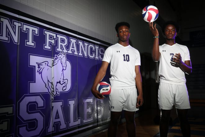 Jude Agyapong (left) and Jamie Momoh are best friends and standout middle hitters for the DeSales boys volleyball team. They're also standout students who aspire to become cardiologists. Agyapong will be attending Johns Hopkins and Momoh is going to Harvard.