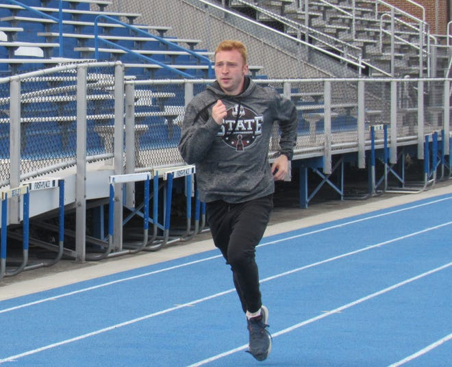Bexley senior Spencer Stevenson runs before practice May 5. He is nearing a program record for the boys track and field team in the 800 after excelling in the 400 in past seasons. He has run the 800 in 1:58.52 and hopes to walk on to the Air Force Academy track team.