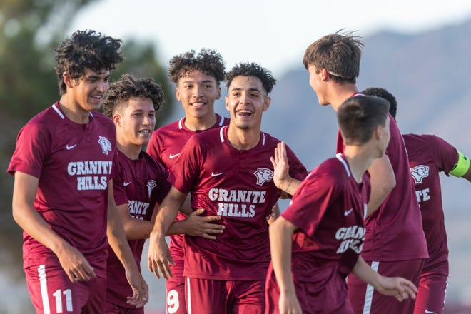 Granite Hills' Jose  Martinez, center, celebrates with teammates after scoring against Adelanto on Wednesday.
