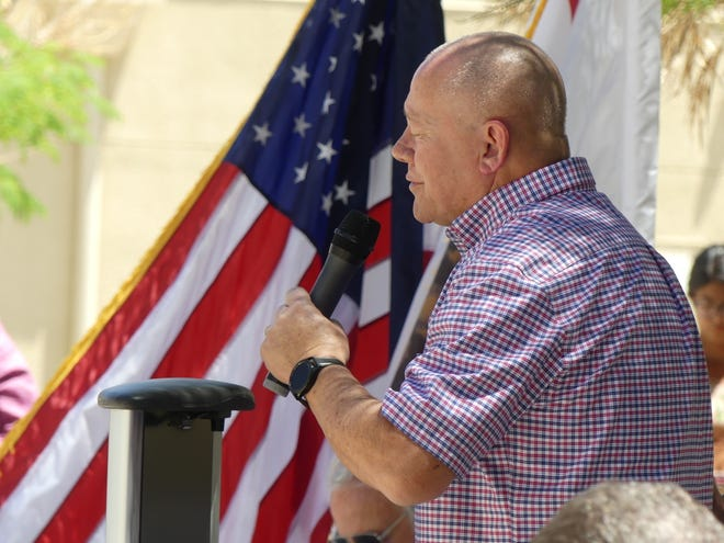 Pastor Gary Malkus, of Calvary Chapel Apple Valley, prays during the National Day of Prayer ceremony on Thursday, May 6, 2021, in the courtyard of Apple Valley Town Hall.