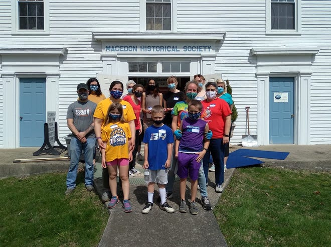 Gananda students and members of Macedon's Scout Cub Pack 166 help the Macedon Historical Society prepare the Academy for upcoming events.