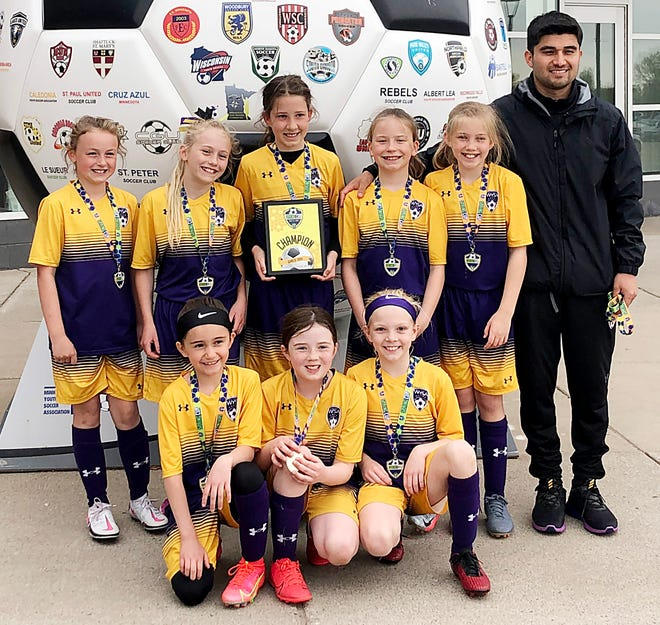 The Watertown Youth Soccer Association's U9-10 Girls Impacto team won its division over the weekend in the National Sports Center Spring Cup outdoor soccer tournament at Blaine, Minn. Team members include, from left in front, Sophia Gallardo Popham, Isabelle Gerlach nd Berkley Fligge; and back, Avah Meyer, Eloise Olson, Alivia Ringgenberg, Lauren Tesch, Jenny Bevers and coach Jorge Gallardo.